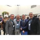 Hervé Boulle, Joseph Brousset et Philippe Lemaire, délégués régionaux de l'ADGCF, entourent Simon Munch, DGS de la région Occitanie